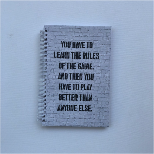 """A5 Hard Cover Notebook - """"You have to learn the rules of the game. And then you have to play better than anyone else."""""""